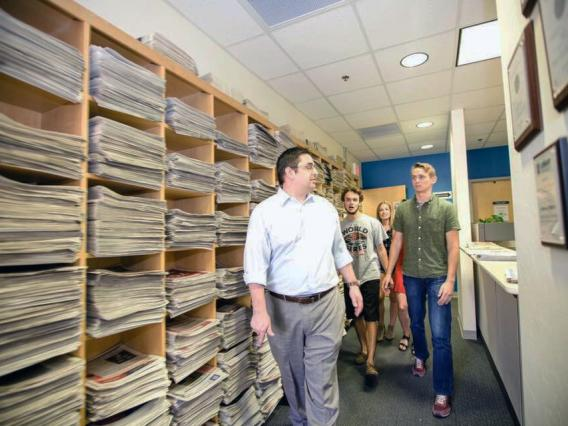 students and director in Wildcat archives