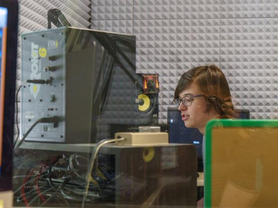 Student in production booth