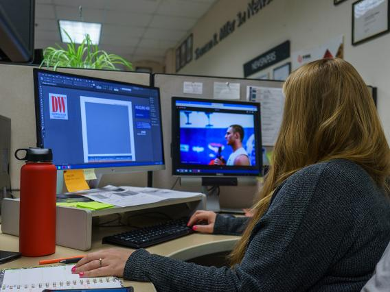 Student using InDesign